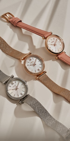 Three womens Fossil watches.